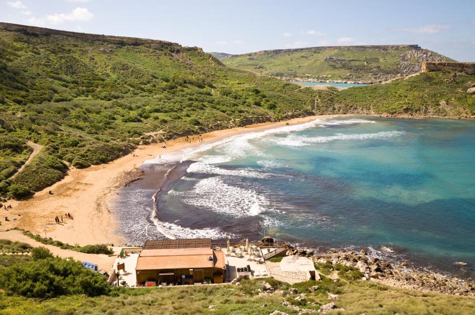 Long beautiful beach post- coronavirus, Malta