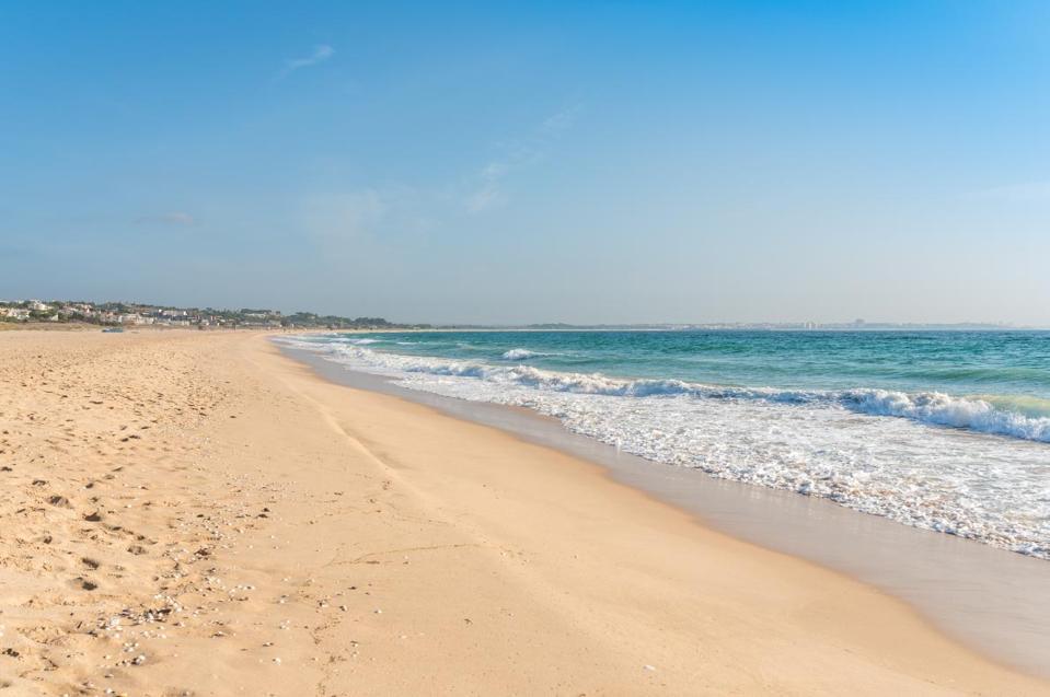 Long, beautiful beach post coronavirus in Algarve, Portugal