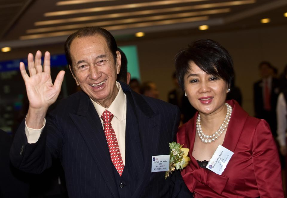 Casino tycoon Stanley Ho (L) with his fo
