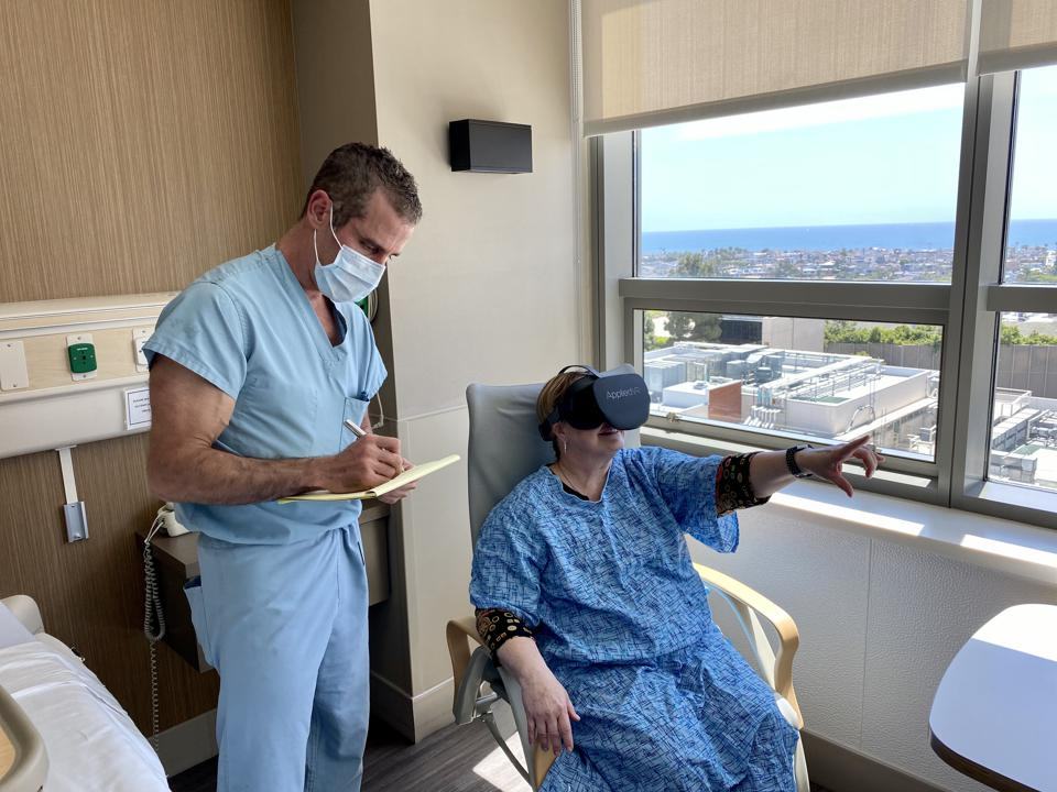 A patient using virtual reality goggles to enter a pain-free world.