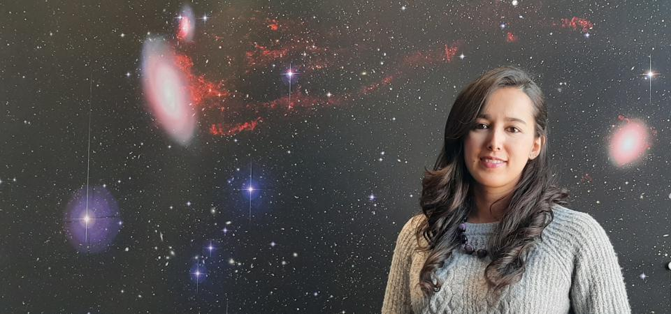 Colombian Valentina Abril Melgarejo  in front of an image of the Virgo cluster of galaxies