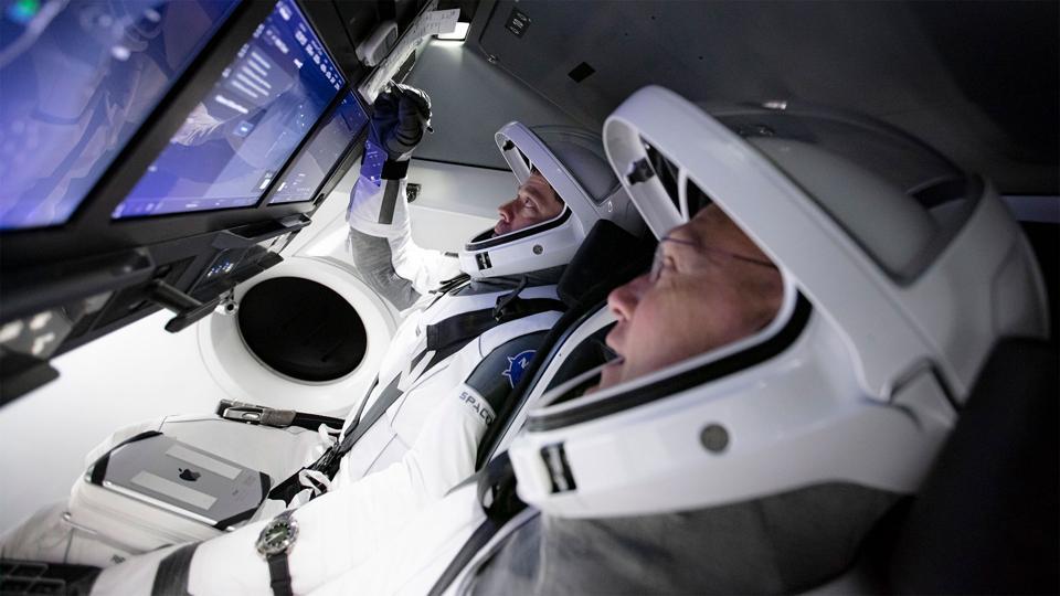 Astronauts Bob Behnken & Doug Hurley inside a Crew Dragon as part of Commercial Crew training.
