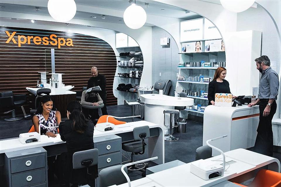 XpresSpa airport store offering massage services, pedicures and manicures, and travel products such as neck pillows and blankets