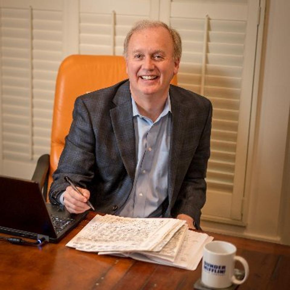 Richard Schelp at his desk at Executive Speakers Bureau