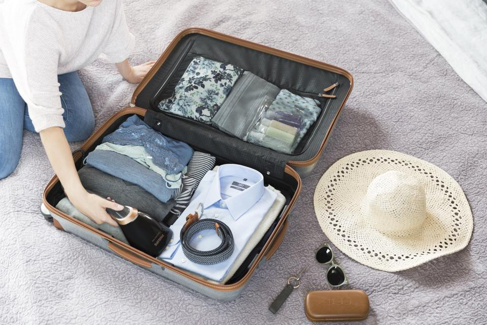 The Philips Steam & Go Plus travel steamer in a suitcase.