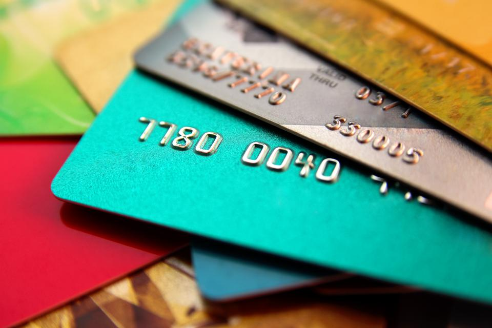 stack of multicolored credit cards, close up view with selective focus