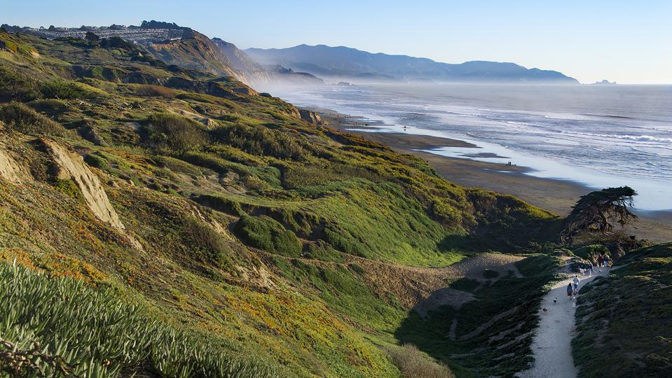 Travel Like a Local - Brief- People walking trail down to Fort Funston Beach.