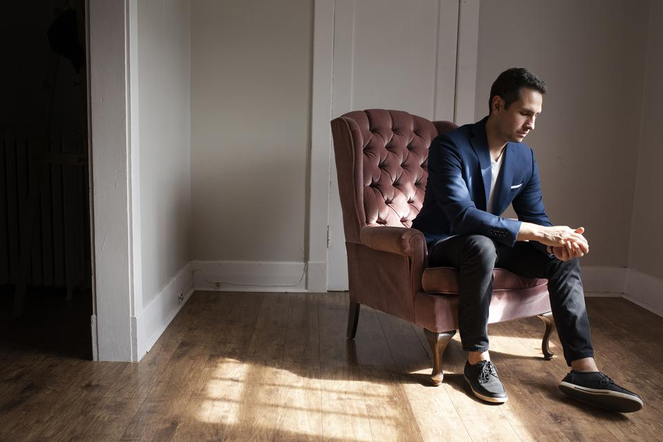 Tarek in a pink chair.