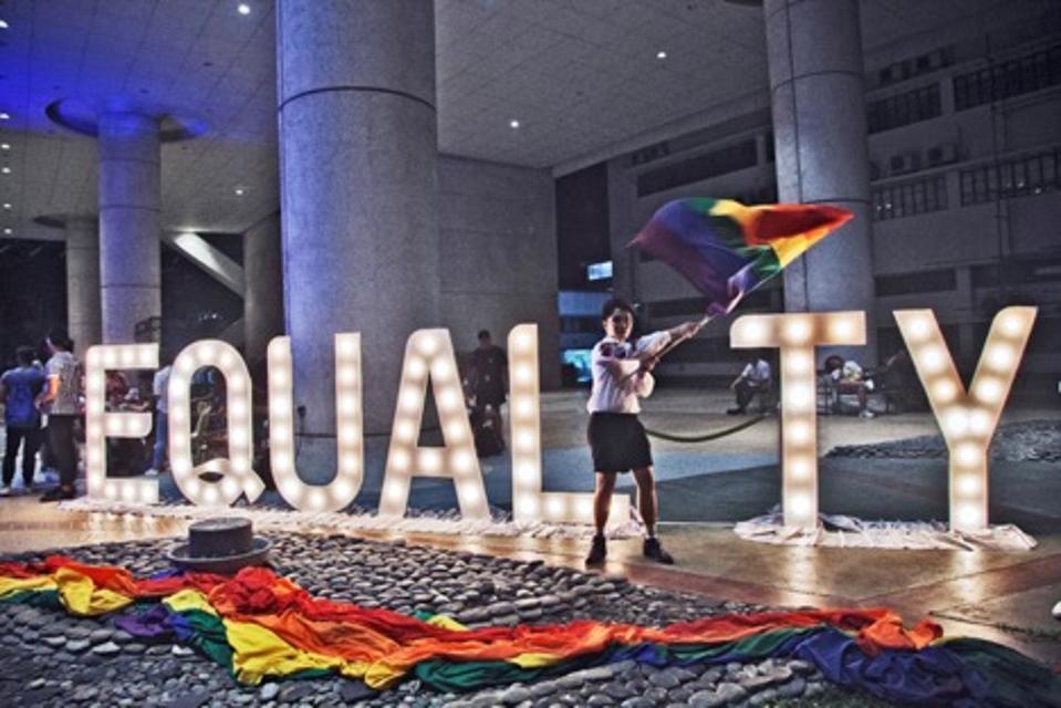 LGBTQ activist dances at a May 2018 event