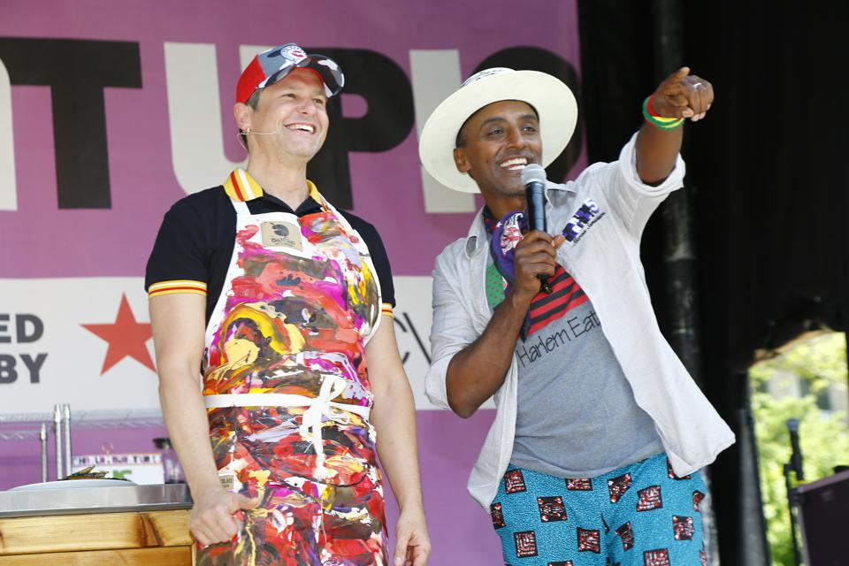 Chef Marcus Samuelsson (right) in 2019, on the main stage of Harlem Eat Up!, his food festival.