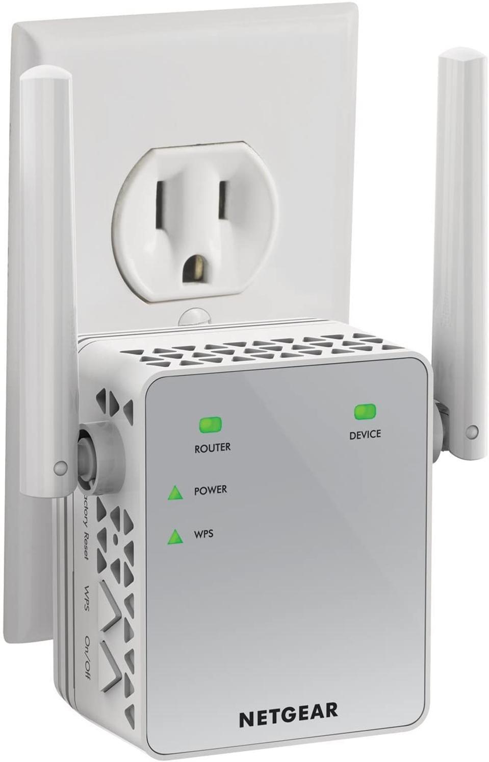 Netgear wifi range extender plugged into an outlet