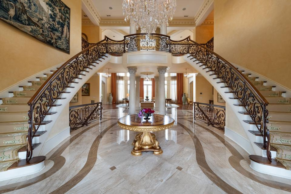 Grand foyer with double staircase and chandelier