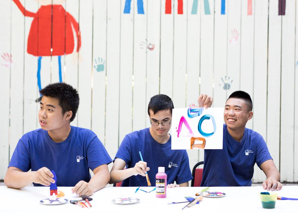 Allen Li and other participants painting at the Center for All Abilities.