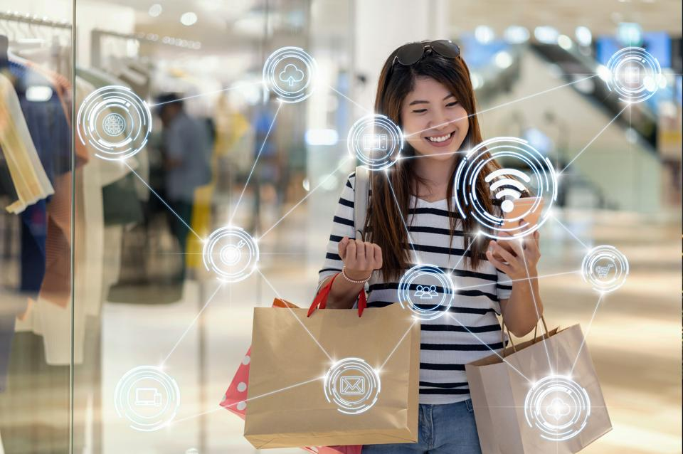 online shopping concept, Happy Asian woman using the smart mobile phone for checking the product and price via Wireless communication connecting of smart city Internet of Things Technology,