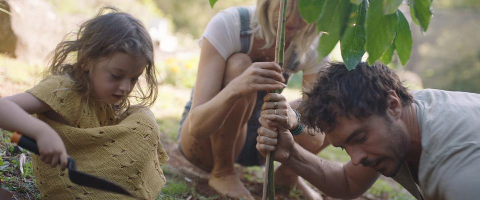Damon Gameau plants a tree with his daughter Velvet and wife Zoë Gameau