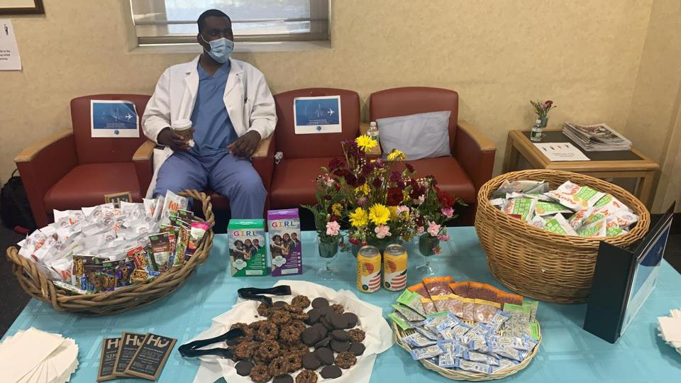 A healthcare worker relaxes with coffee and treats in a new Project Wingman lounge.