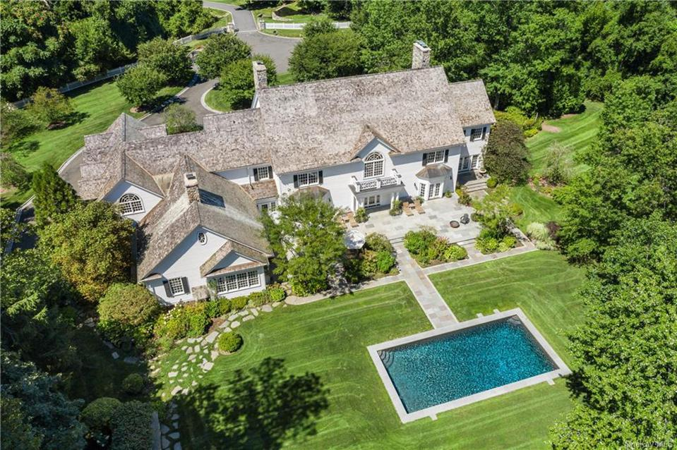 A Purchase, N.Y. house with 9,763 square feet including 6 bedrooms, 10 bathrooms. The asking price is $3,999,.000 and a contract was signed on 5/23/20. The house was first listed in 2017 for $5.695 million.