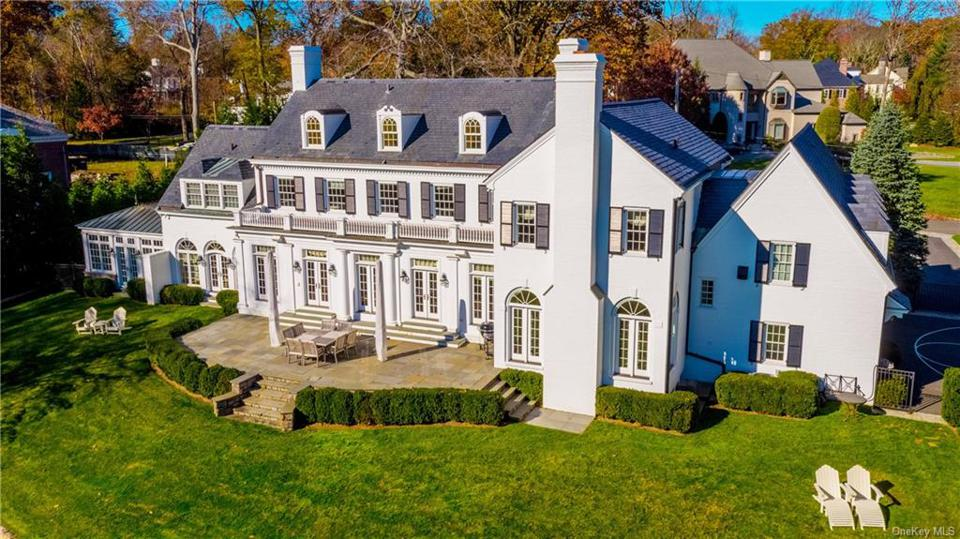 A Scarsdale, NY house with 7,000 sq.ft. including 6 bedrooms, 7 baths. The asking price is $4,250,000 and a contract was signed on 5/28/20. The house was first listed in 2018 for $5,499,000.