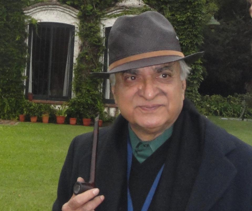Picture of Deepak Lal, relaxed with a pipe, in front of Argentine estancia