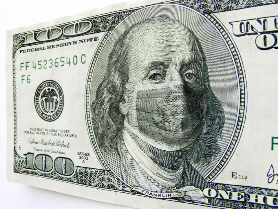 Ben Franklin wearing a COVID-19 Healthcare Mask on a One Hundred Dollar Bill.