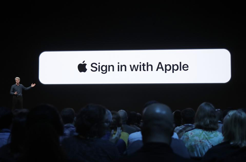 Apple executive giving a Sign in with Apple presentation on stage in front of an audience