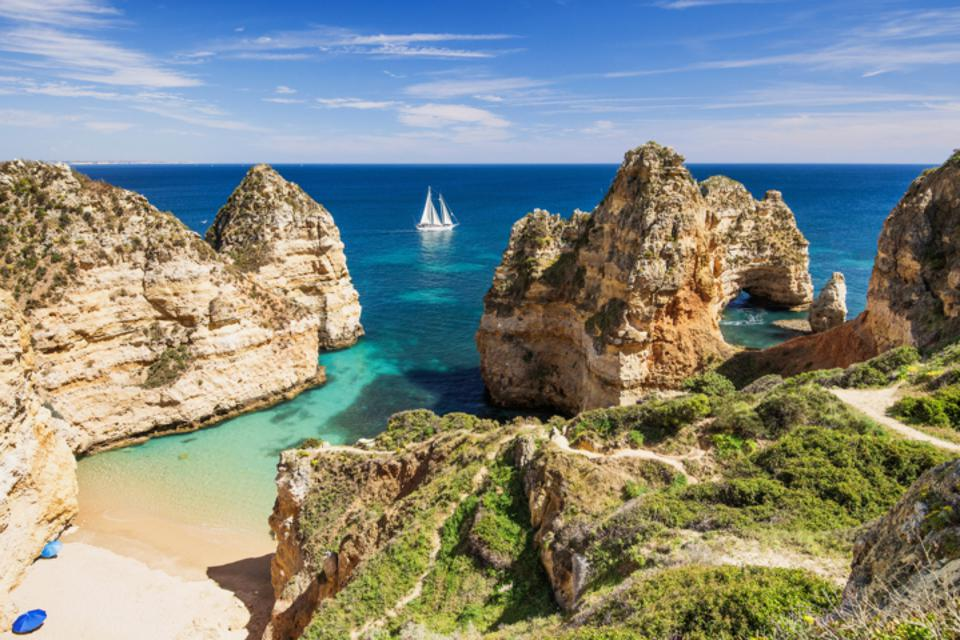 The blue sea and a beach in The Algarve, Portugal