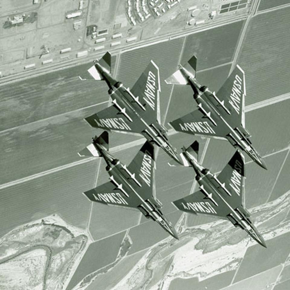 Blue Angel F-4J Phantoms in the diamond formation.