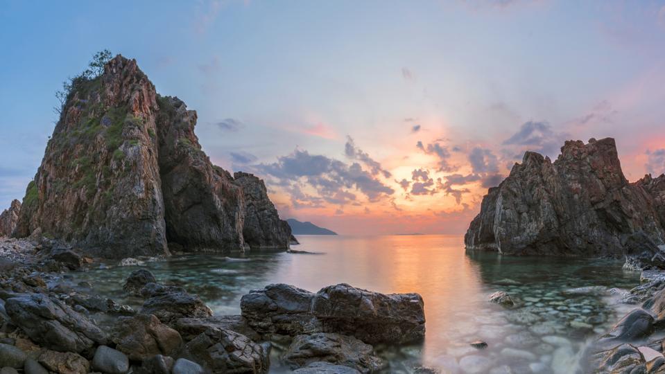 Big rock at sea coast in morning sunlight