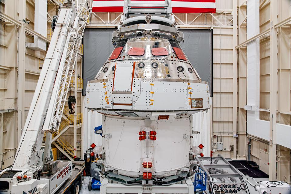 NASA's Orion spacecraft–the crew module and European-built service module—is being lifted into a thermal cage and readied for its move on Tuesday into the vacuum chamber at NASA's Plum Brook Station for testing.