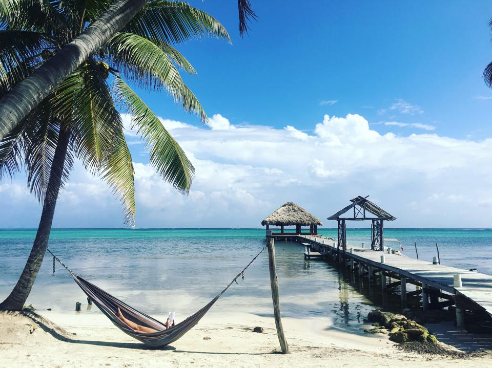 A hammock in front of the Caribbean Sea in Belize