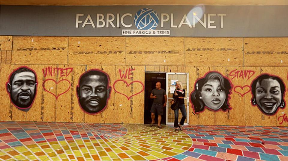 A Fabric Planet shop window on board, with spray-painted murals