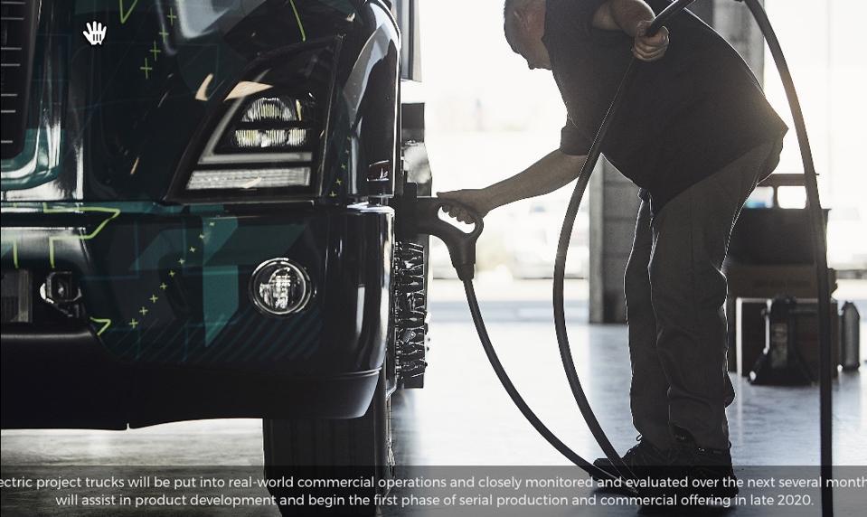 Man charging his Volvo Truck