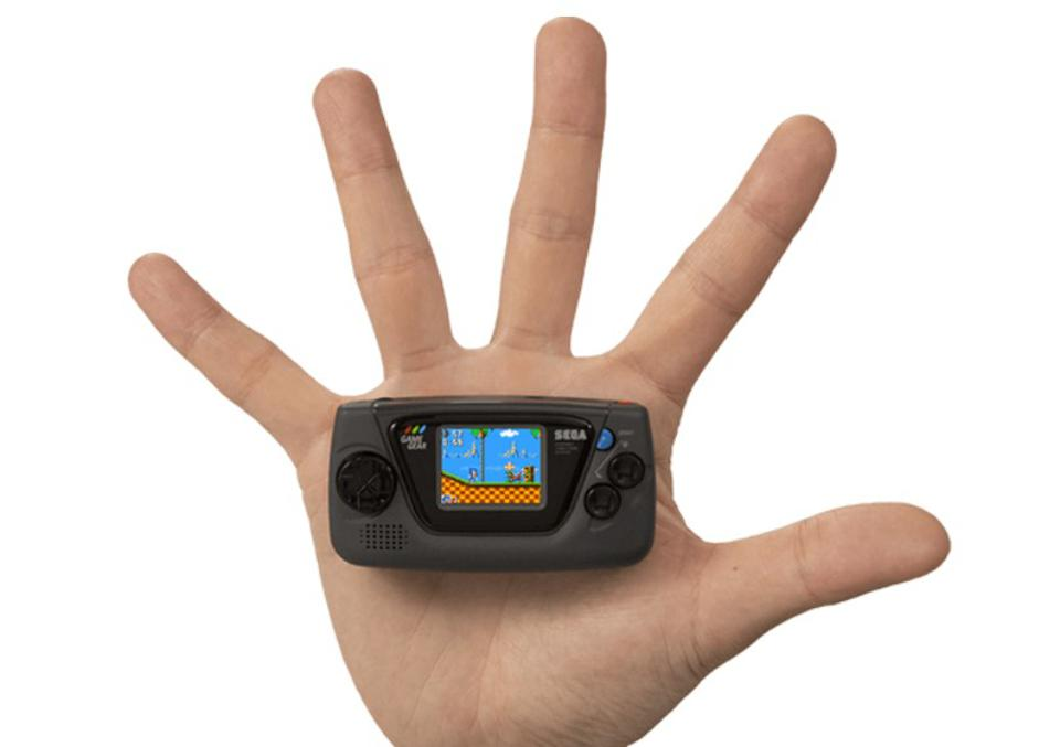 Sega's Game Gear Micro, placed on top of a hand for scale