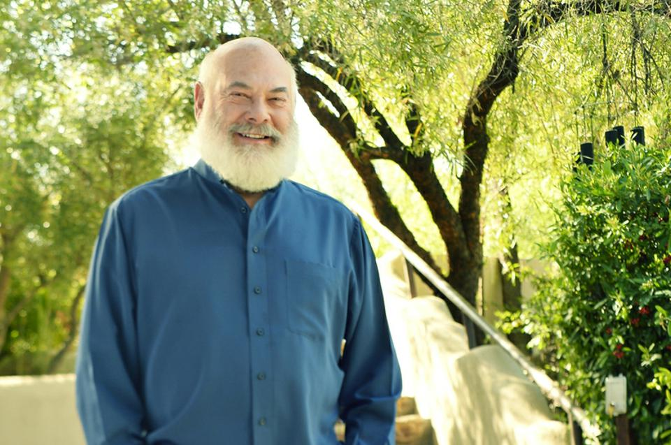 A portrait of Dr. Weil in front of a tree