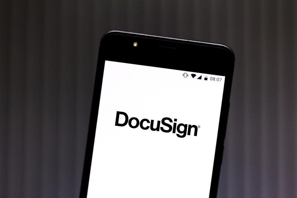 In this photo illustration a DocuSign logo seen displayed on...