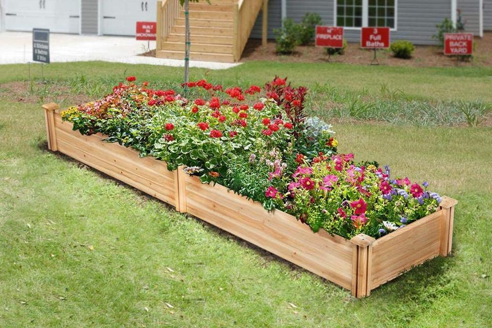 Yaheetech Raised Garden Bed Kit with flowers in yard