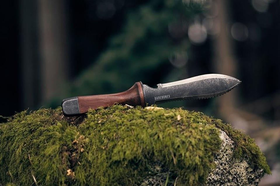 Barebones Hori Hori ultimate tool on moss-covered rock