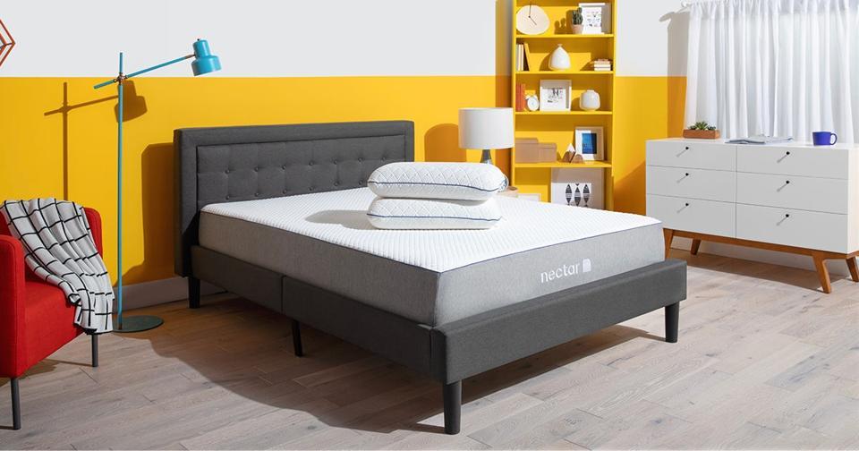 A nectar sleep memory foam mattress on an upholstered bed