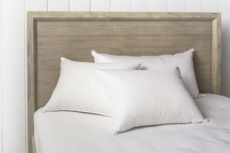 Three Parachute Down Alternative pillows on a bed