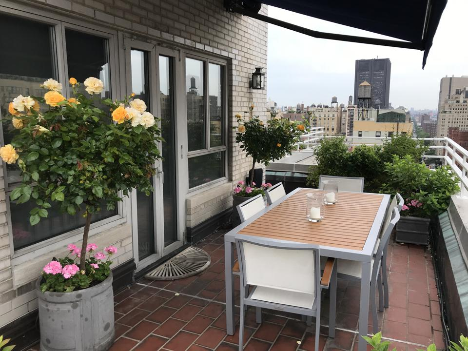 The Robertson's terrace on the Upper East Side. This duplex apartment has a lushly landscaped terrace that encompasses the entire entertaining space.