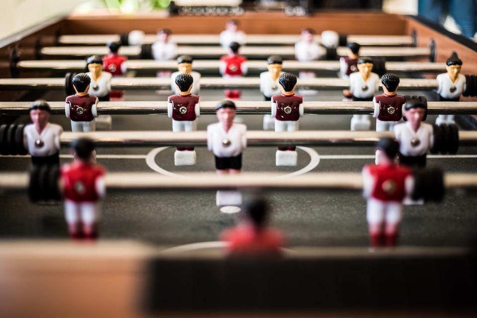 Table football players facing one another.