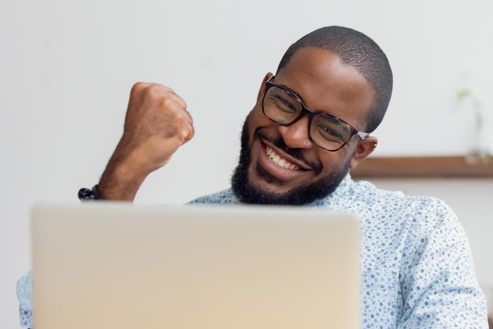 Happy man looking at screen.