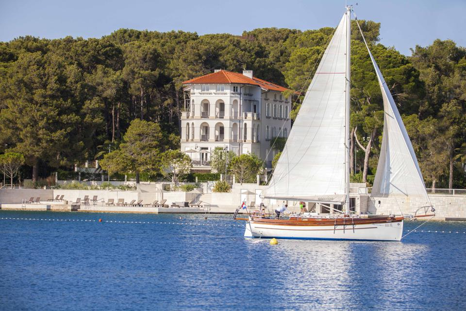 sailboat and villa on the Mediterranean