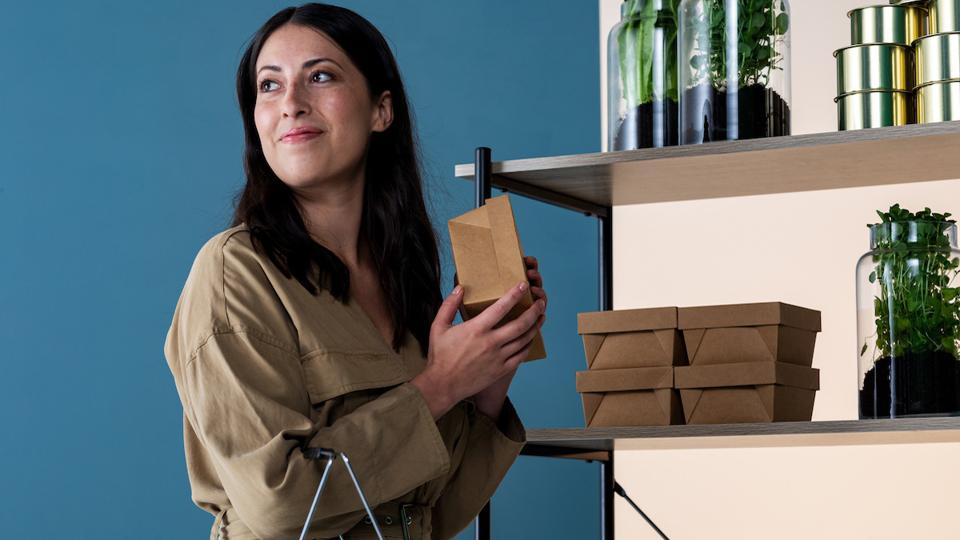 woman holding a box in room