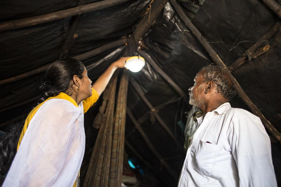 Pollinate Group entrepreneur selling a solar light to a customer in Bangalore