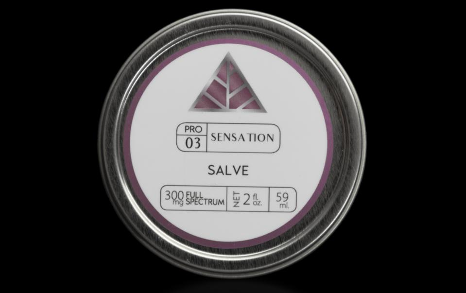 tin of cbd salve on black background