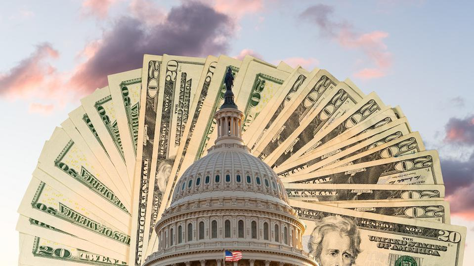 US Capitol in Washington DC with cash behind