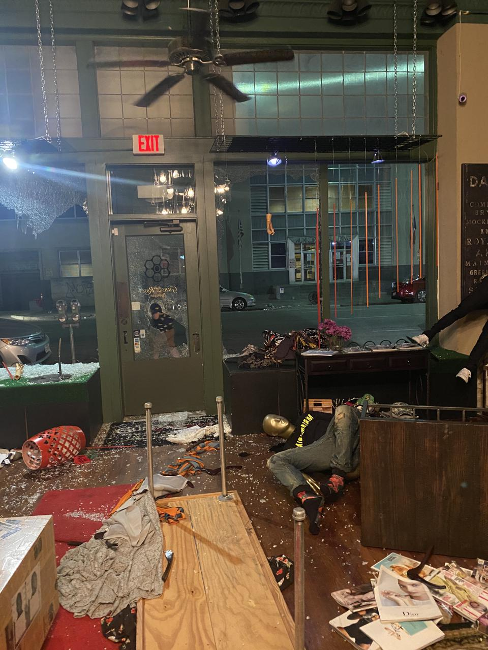 Guns & Roses Boutique in Dallas, TX after looters smashed the windows and stole merchandise.