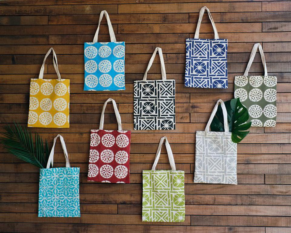 Eight different tote bags for sale from Rise Beyond the Reef