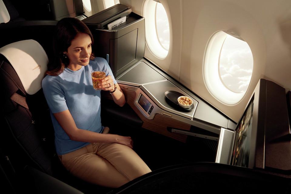 British Airways New Club Suite with female passenger